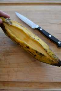 Cutting open a plantain