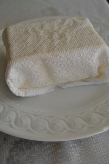 Tofu wrapped in paper towels