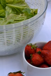 Mixed greens and strawberries