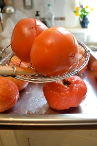 A spider is a great tool for removing the tomatoes from the boiling water