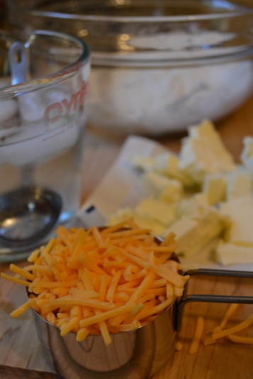 Grated cheddar cheese for crust