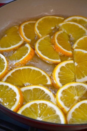 Oranges simmering in sugar syrup