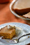 Slice of Pumpkin Pie with Gingersnap Crust and Molasses Whipped Cream